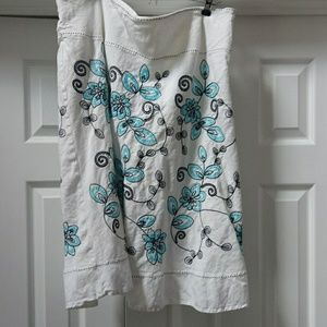 White linen skirt with teal and black embroidery